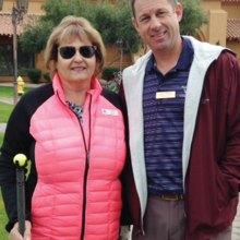 Linda Boyd with Golf Pro Jason