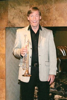 Bill Throssell with his trumpet at the Tuscany Falls Clubhouse