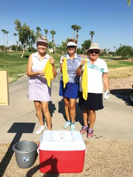 Left to right: Cheryl Skummer, Deb Smedley and Layne Sheridan enjoyed cool towels during a summer round on the course.
