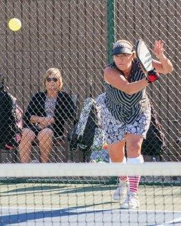Mo Richardson sends off a mean serve; Photo by Dannie Cortez.