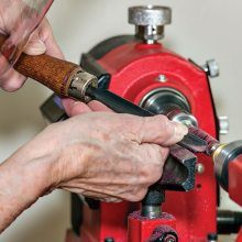Figure 1: Jeannette McElroy working on the lathe.