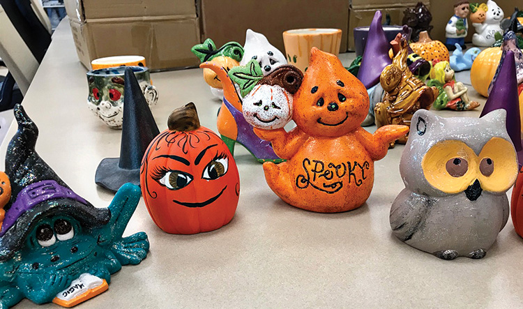 Ornaments (witches, ghosts, pumpkins, and so on) were presented to the children.
