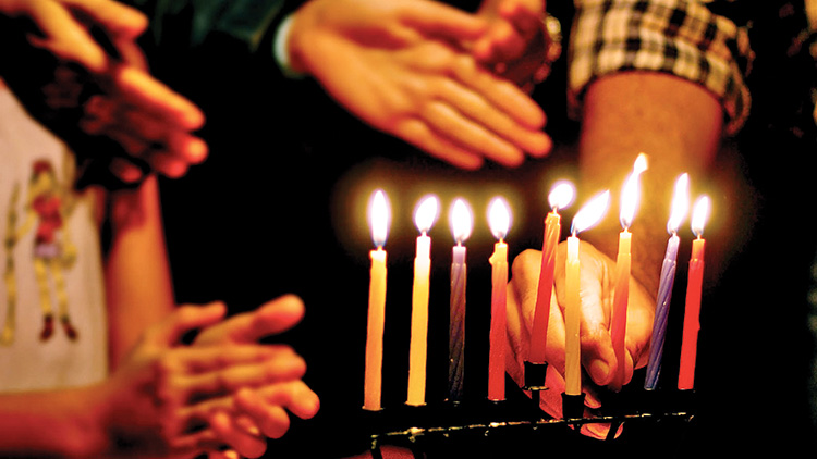 """The Shalom Club celebrated a traditional Chanukah celebration. The holiday is known as the """"Festival of Lights."""""""