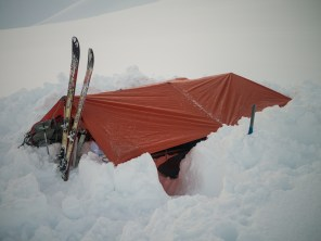 A frame tarp. Help up by ski poles.