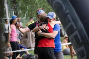 Waited 12 hours and ran 50 miles for this hug! Photo: Adam Ciuk