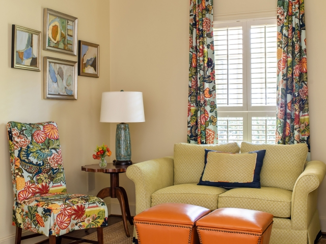 Beretania Circle Residence 10 Sitting room orange leather stools bright floral chair and drapes Pebbles Nix Interiors