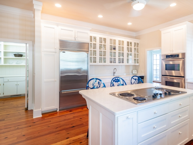 Prince George at Pawley's Island 25 kitchen cabinets white hardwood floors Pebbles Nix Interiors