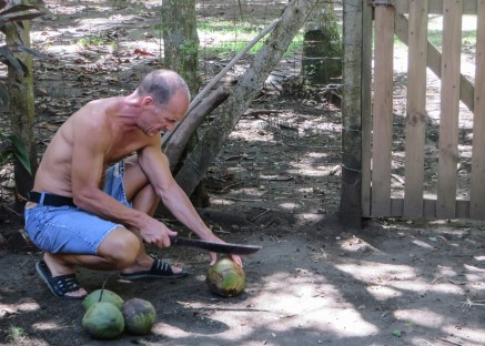 Learning how to open a coconut with a machete. Yes, I still have all my fingers.