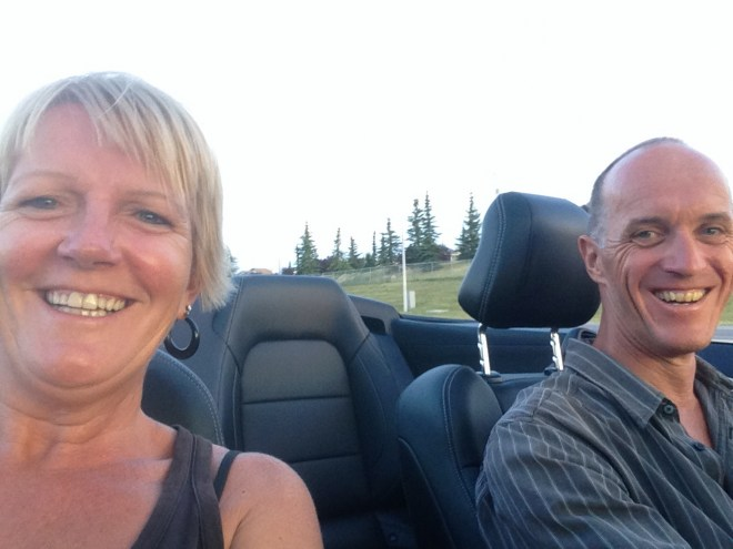 Loving the experience of cruising with the top down in a beautiful Ford Mustang.