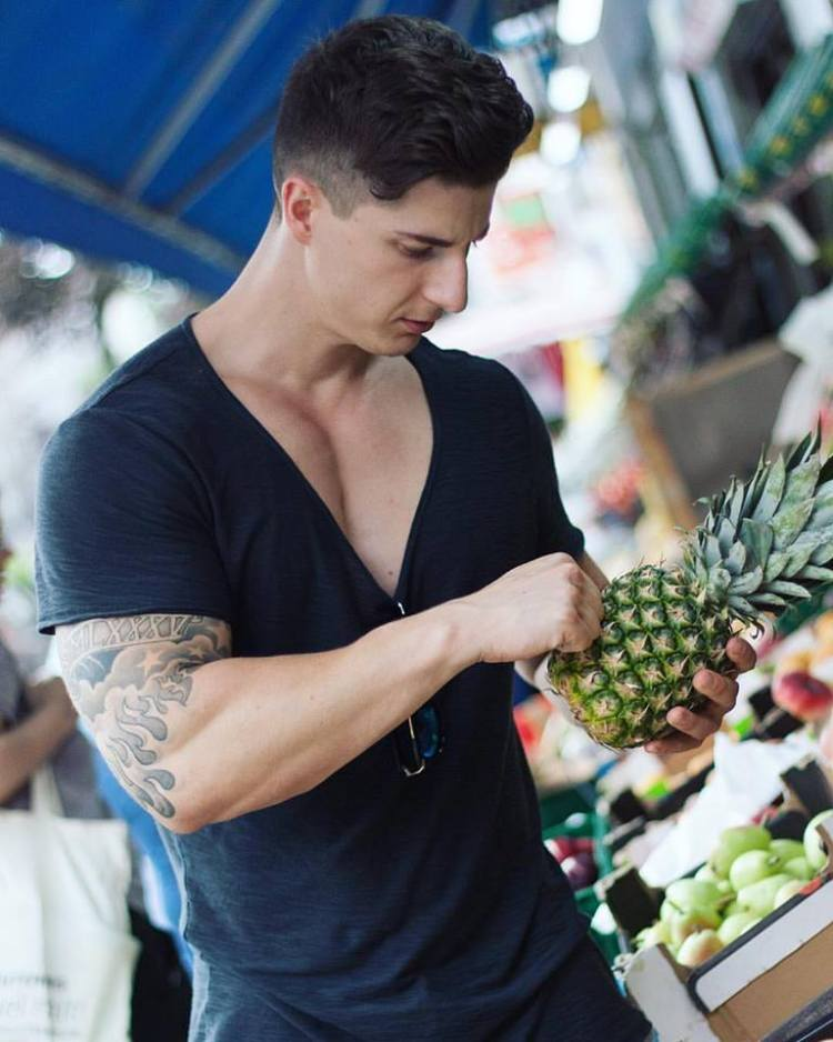 Philipp Berger out shopping for food in a black V-neck. Such a tease.