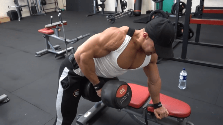 Mike Thurston working out his back while showing off his chest in sexy tank top