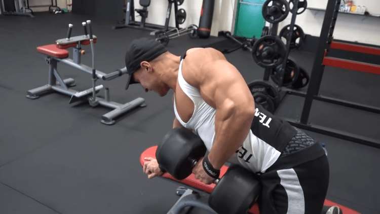 Mike Thurston spilling out of tank top during back workout