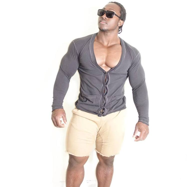 Kwame Duah cardigan barely containing his huge chest