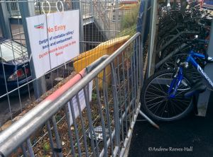 Work on platform 2 has been left unfinished and temporary fencing erected with signs telling of dangers and warning off would-be parking of bicycles.