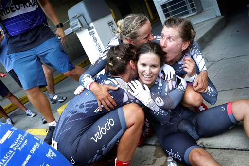 Canuel and teammates celebrate at the finish [P] Cor Vos