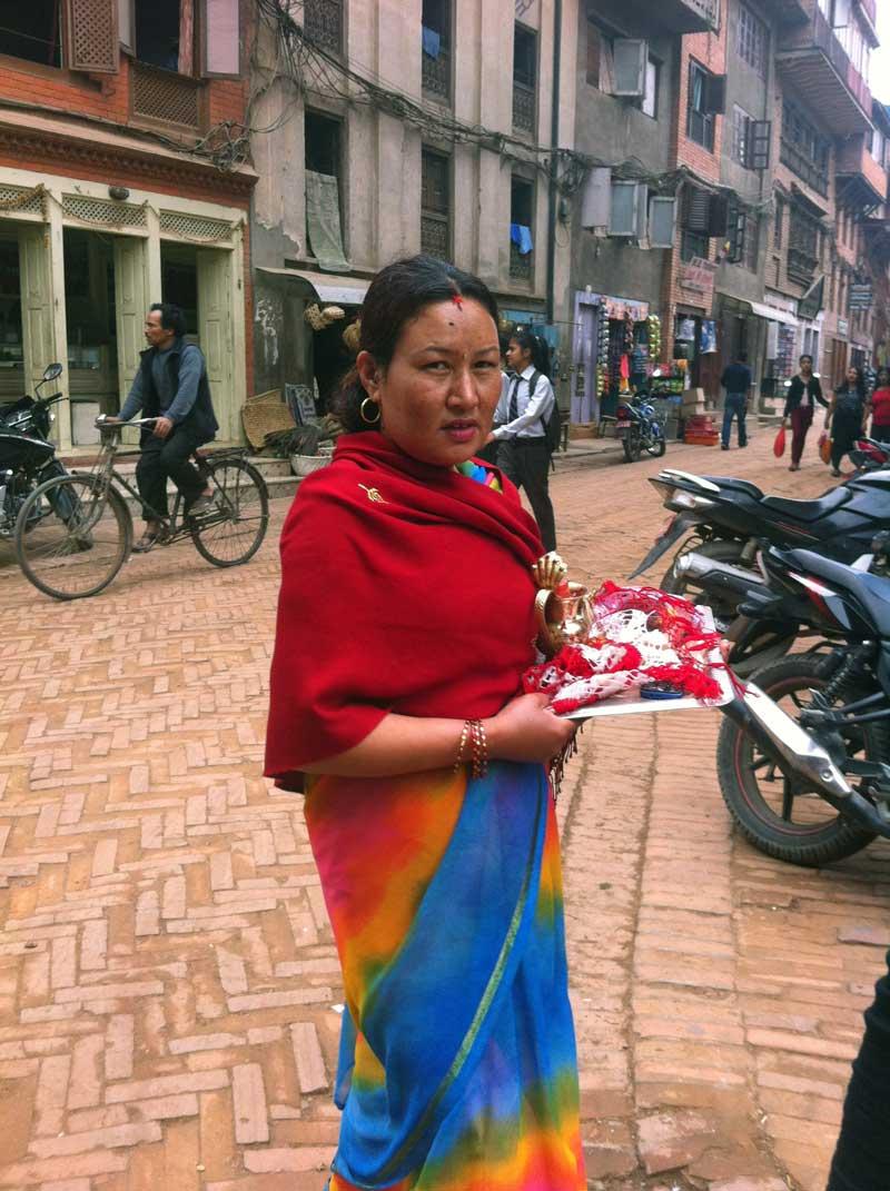 Hindu woman carrying ritual gifts