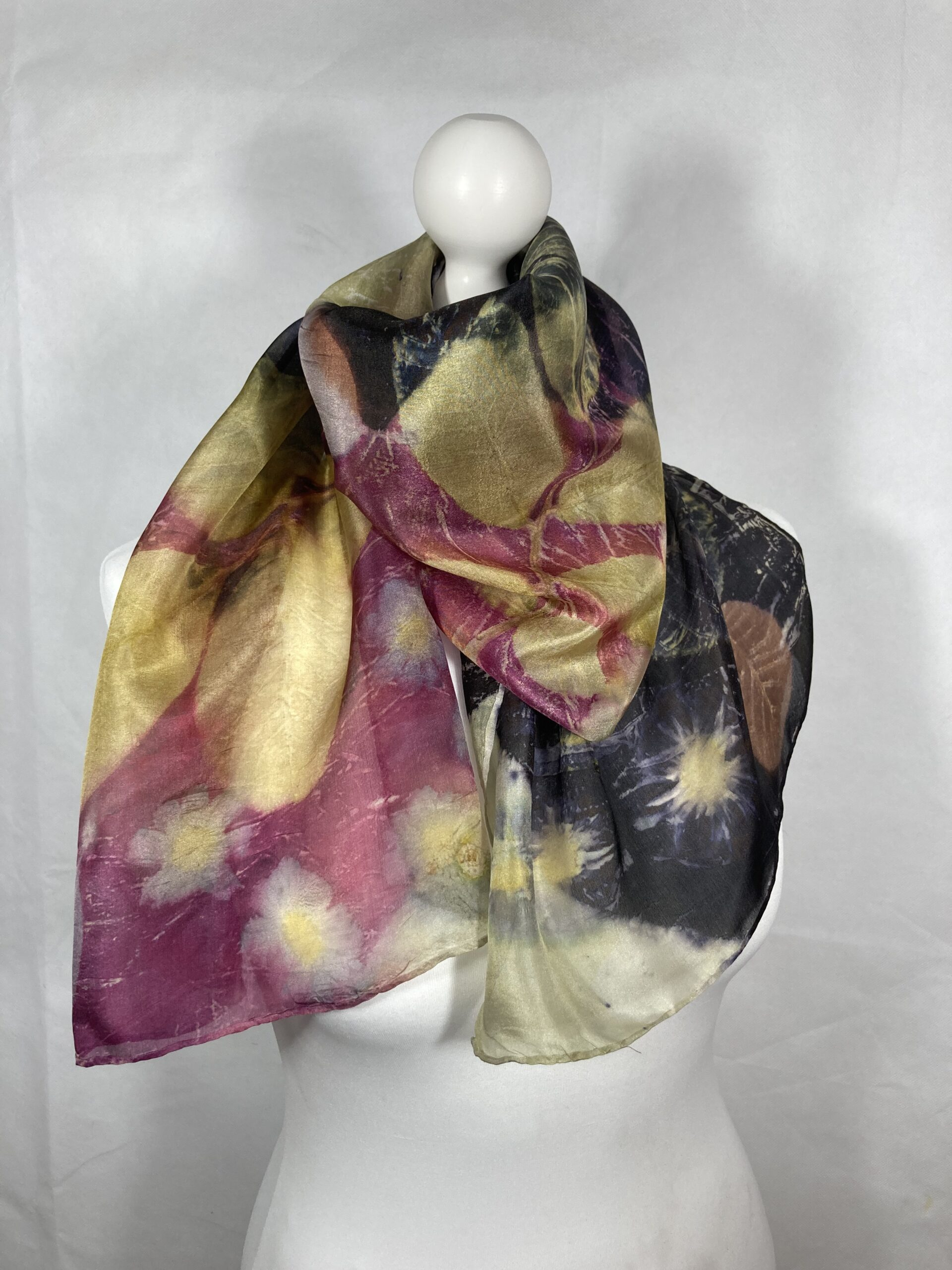 By Maggie Naturally. Multicoloured Pongee 5 silk scarf, handdyed with logwood, weld and cochineal and hand printed with autumn leaves from my garden