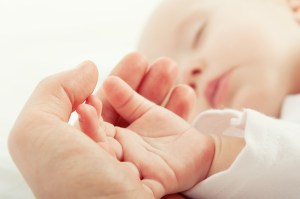 Baby's hand in mothers
