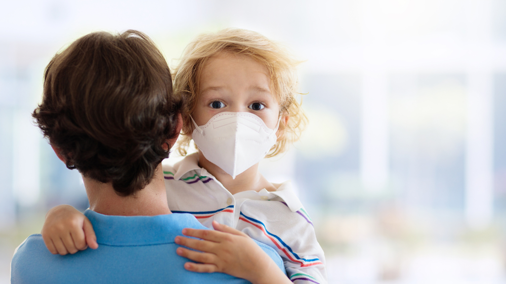 child with facemask
