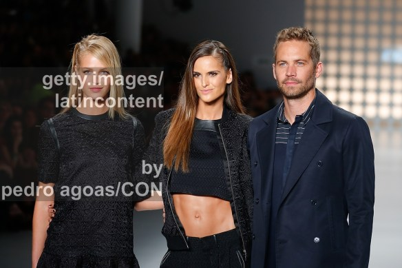 SAO PAULO, BRAZIL - MARCH 21: Isabel Goulart, Erin Heatherton and Paul Walker walking the runway showing a design by Colcci during São Paulo Fashion Week (SPFW) Summer 2013/2014 on March 21, 2013 in São Paulo, Brazil. (Photo by Pedro Agoas/LatinContent/Getty Images)