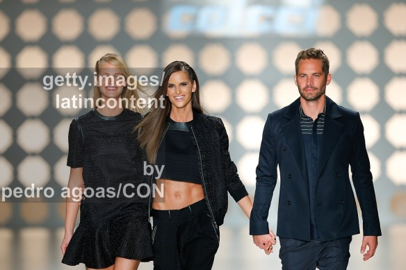 SAO PAULO, BRAZIL - MARCH 21: Isabel Goulart, Erin Heatherton and Paul Walker walking down the runway showing a design by Colcci during São Paulo Fashion Week (SPFW) Summer 2013/2014 on March 21, 2013 in São Paulo, Brazil. (Photo by Pedro Agoas/LatinContent/Getty Images)