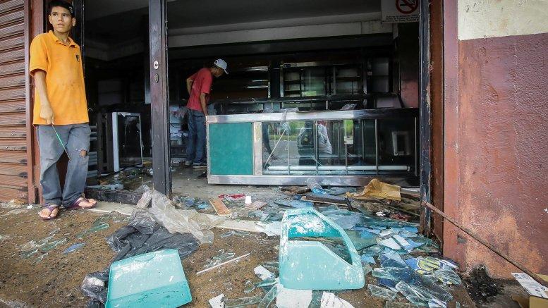 Exonerarán impuestos a comerciantes afectados por saqueos en Bolívar - Exonerarán impuestos a comerciantes afectados por saqueos en Bolívar