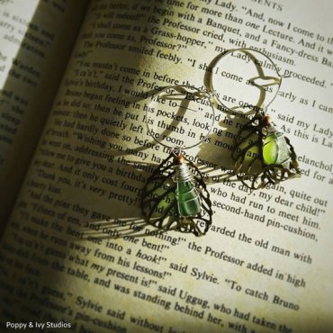 Bohemian hoop earrings with green seaglass & bronze falling leaves by Poppy and Ivy Studios. €20 http://etsy.me/1NSfNXj