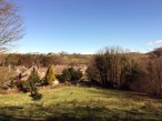 Ingleborough over village