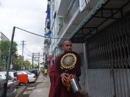 Traditional uniform of a monk (Yangon) : robe, fan, meal iron box