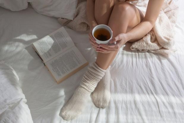 Girl with Tea on Bed_329565530.jpg