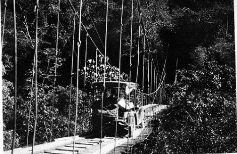 """""""Automobile crossing rope bridge. 1923."""" Photograph made accessible by the Field Museum Library. http://www.flickr.com/photos/field_museum_library/4462494439/"""