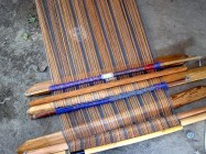 5.3 sticks with loops., stick with orange weft wound on., flat machete sticks