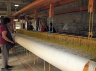 7.6 huge loom from the back, people standing around for scale