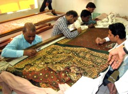 4.6 four men in embroidery workshop