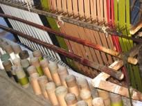 14.5 tubes of warp yarn and 2 ms boos sticks holding cross