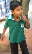15.9 boy tasting rice powder