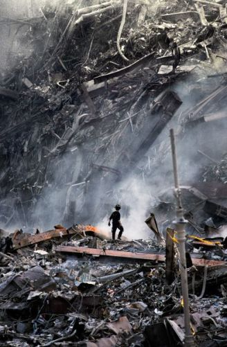 Rescue workers search a mountain of wreckage after the collapse of the World Trade Center's Twin Towers, New York, NY, September 11, 2001. MCS2001005K104 final print_milan
