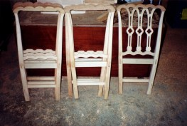 Some of the partially constructed chair frames.
