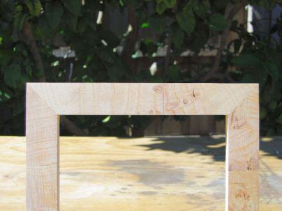 Bare upper door frame.