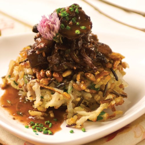 Wild Mushroom Ragoût on a Manitoba Wild Rice Latke by Chef Michael Neil of Pineridge Hollow