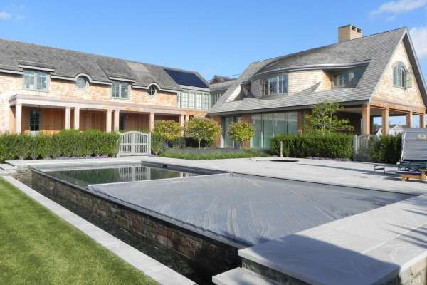 Infinity Edge Pool with Tracked Automatic Cover