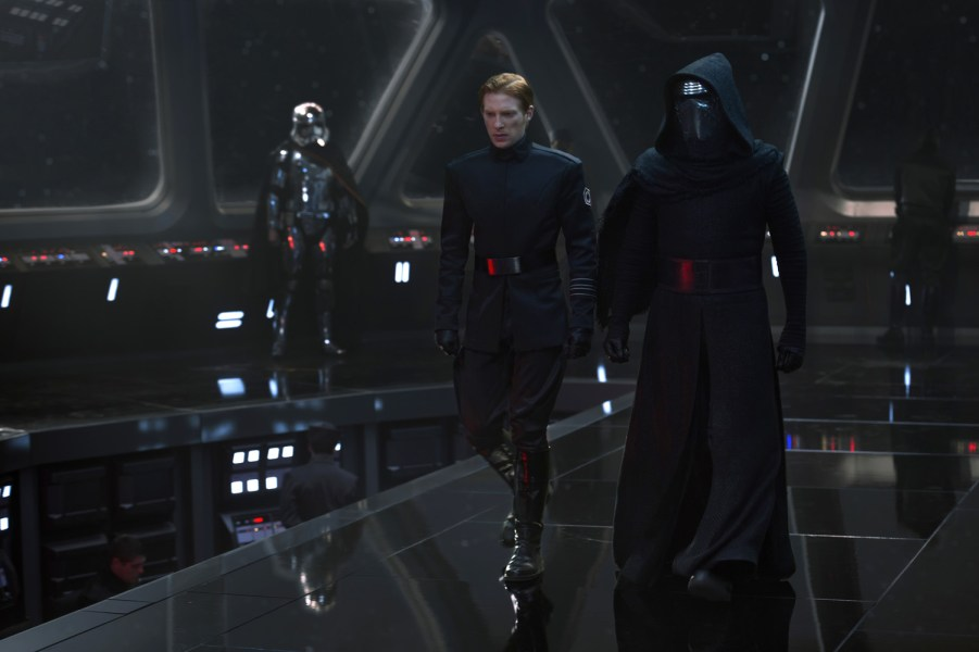 Star Wars: The Force Awakens..L to R: General Hux (Domnall Gleeson) and Kylo Ren (Adam Driver), in b/g Captain Phasma (Gwendoline Christie)..Ph: David James..? 2015 Lucasfilm Ltd. & TM. All Right Reserved.