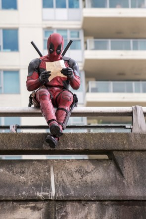 DEADPOOL Ryan Reynolds as Deadpool relaxes before leaping into battle. Photo Credit: David Dolsen TM & © 2015 Marvel & Subs. TM and © 2015 Twentieth Century Fox Film Corporation. All rights reserved. Not for sale or duplication.
