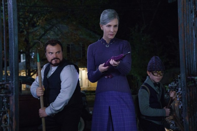 "Uncle Jonathan (Jack Black), Mrs. Zimmerman (Cate Blanchett) and Lewis Barnavelt (Owen Vaccaro) face down some dark magic in ""The House With A Clock in Its Walls,"" the spine-tingling, magical adventure of a boy who goes to live with his eccentric uncle in a creaky old house with a mysterious tick-tocking heart. Based on the first volume in the beloved children's series of books, the film is directed by master frightener Eli Roth."