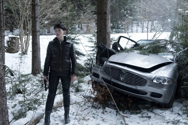 """Lisbeth Salander (Claire Foy) and a crashed Maserati in Columbia Pictures' THE GIRL IN THE SPIDER'S WEB"""""""