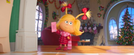Cindy-Lou Who (Cameron Seely) gets ready to mail her letter to Santa in Dr. Seuss' The Grinch from Illumination.