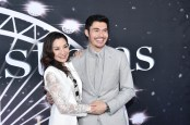 """NEW YORK, NEW YORK - OCTOBER 29: Michelle Yeoh and Henry Golding attend """"Last Christmas"""" New York premiere at AMC Lincoln Square Theater on October 29, 2019 in New York City. (Photo by Steven Ferdman/WireImage,)"""