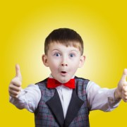 Excited Surprised little boy with thumb up gesture
