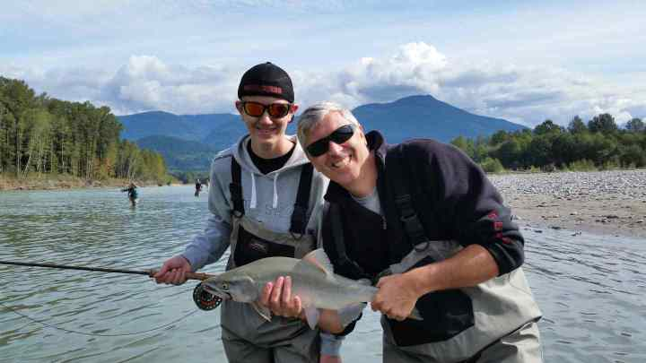 Father and son fly fishing in Squamish BC