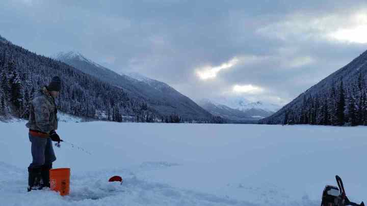 Ice fishing Duffey Lake in British Columbia